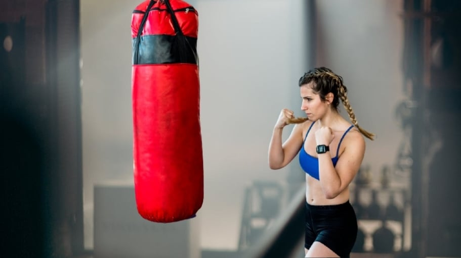 Punching bag workout at home for women